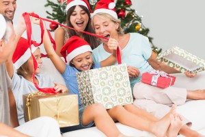 Happy family opening gifts together on Christmas