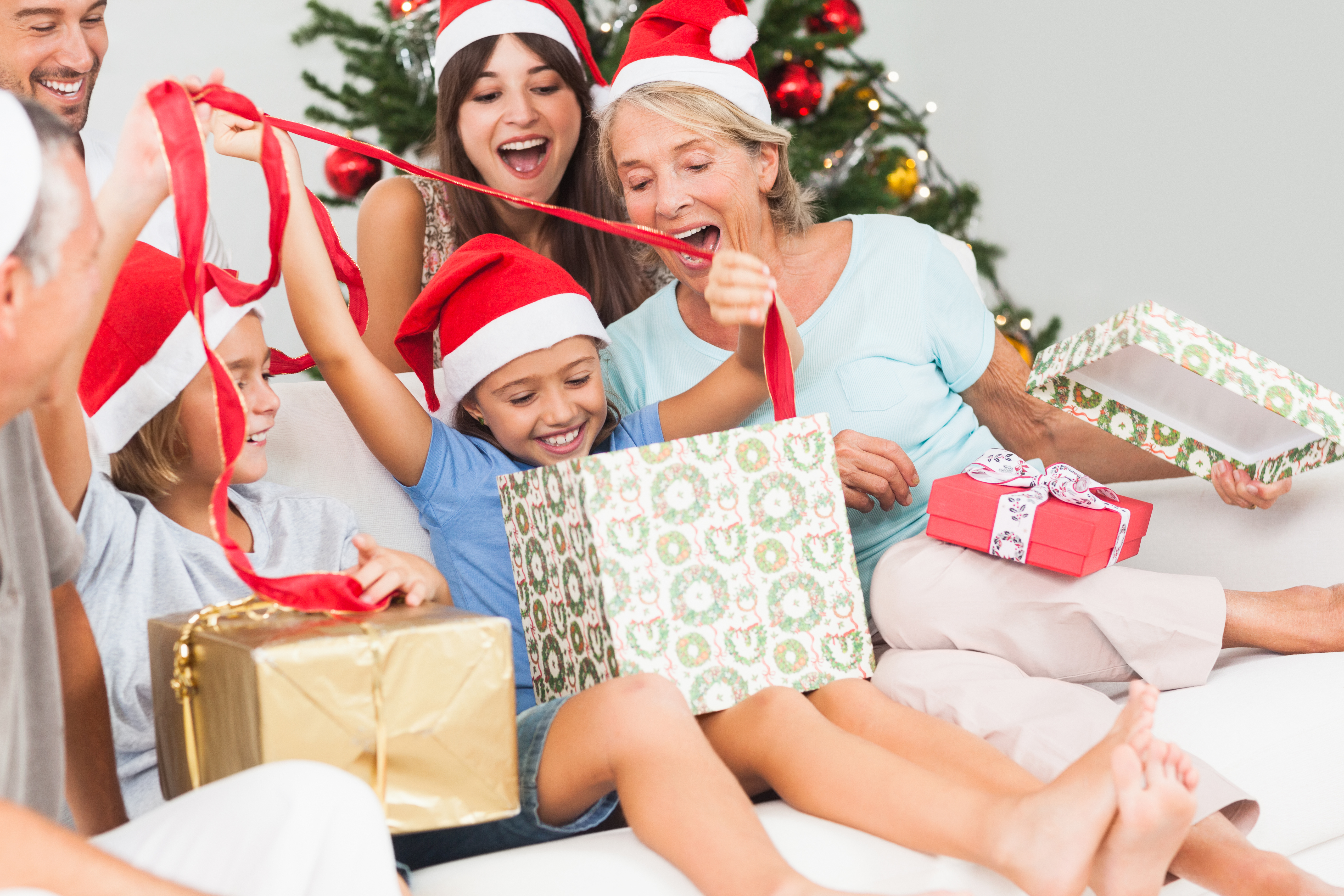 happy family opening gifts together on christmas - Celebrating Christmas